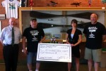 Presentation of cash and food to Wausau's The Neighbors Place (TNP). (L/R) Tom Rau, Exec Dir, TNP, Bob Mohr, contest winner, Aidyn Laurynz, Director of Community Support and John Chmiel, Wausau Flying Service