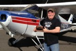 Landings 4 Lunches contest winner Bob Mohr stands in front of his Piper PA-12 Super Cruiser