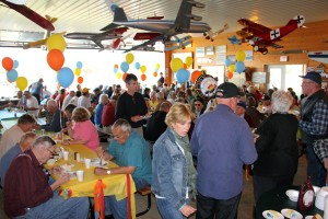 Just part of the crowd celebrating Paul John's 100th Birthday at Iola's Central County Airport