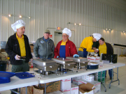 EAA Chapter 60 members cooking pancakes
