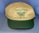 Baseball cap with green trim script over logo