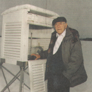 Carl Rindlisbacher at weather box, ca 1990s