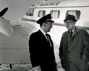 Captain Roy Shwery and his aircraft with a passenger