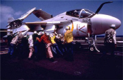 Deck crew moving Grumman A-6