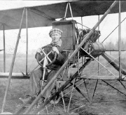 Kaminski at the controls of a Curtiss pusher
