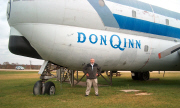 Tom Thomas stands in front of the B-377 (KC-97) that he flew into Dodgeville